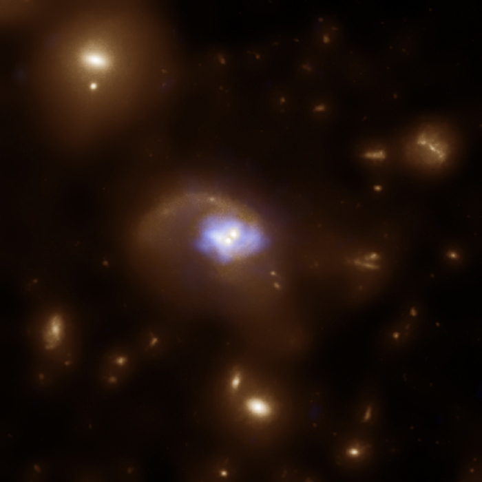 HST and Chandra image composite of recoiling black holes