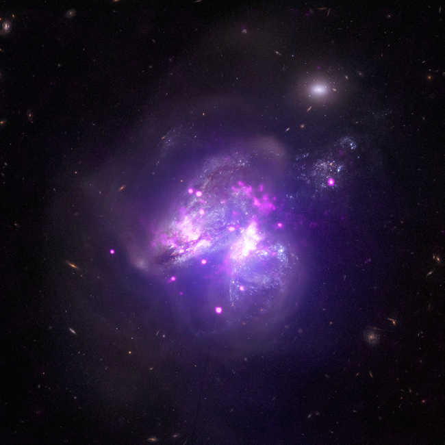 X-ray image from Chandra, NuSTAR superimposed on an optical image of the star forming galaxy Arp 299
