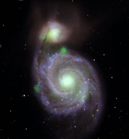 NuSTAR hard X-ray image of the Whirlpool galaxy and M51b compared to the optical